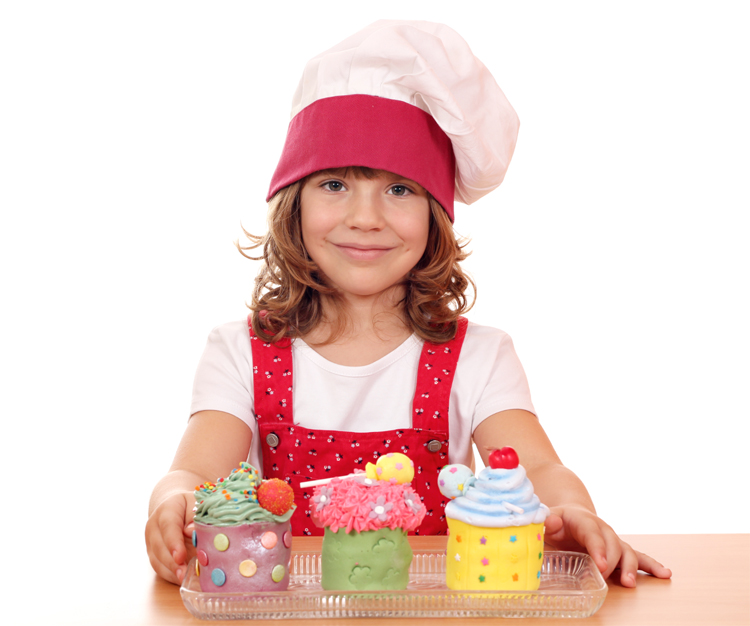 Young girl selling cupcakes